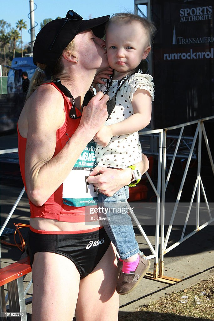 Long distance runner <a gi-track='captionPersonalityLinkClicked' href=/galleries/search?phrase=Deena+Kastor&family=editorial&specificpeople=240301 ng-click='$event.stopPropagation()'>Deena Kastor</a> wins first place at the Kaiser Permanente Rock 'N' Roll Pasadena Half Marathon Benefiting CureMito! at Rose Bowl on February 17, 2013 in Pasadena, California.