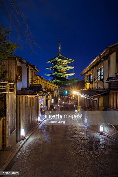 Long exposure blurred motion shot pedestrians passing during the Hanatoro lantern illumination event in Kyoto's Higashiyama district with Yasaka...