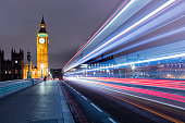 A long exposure of the traffic on the Westminster Bridge and Palace and the Elizabeth Tower with Big Ben.