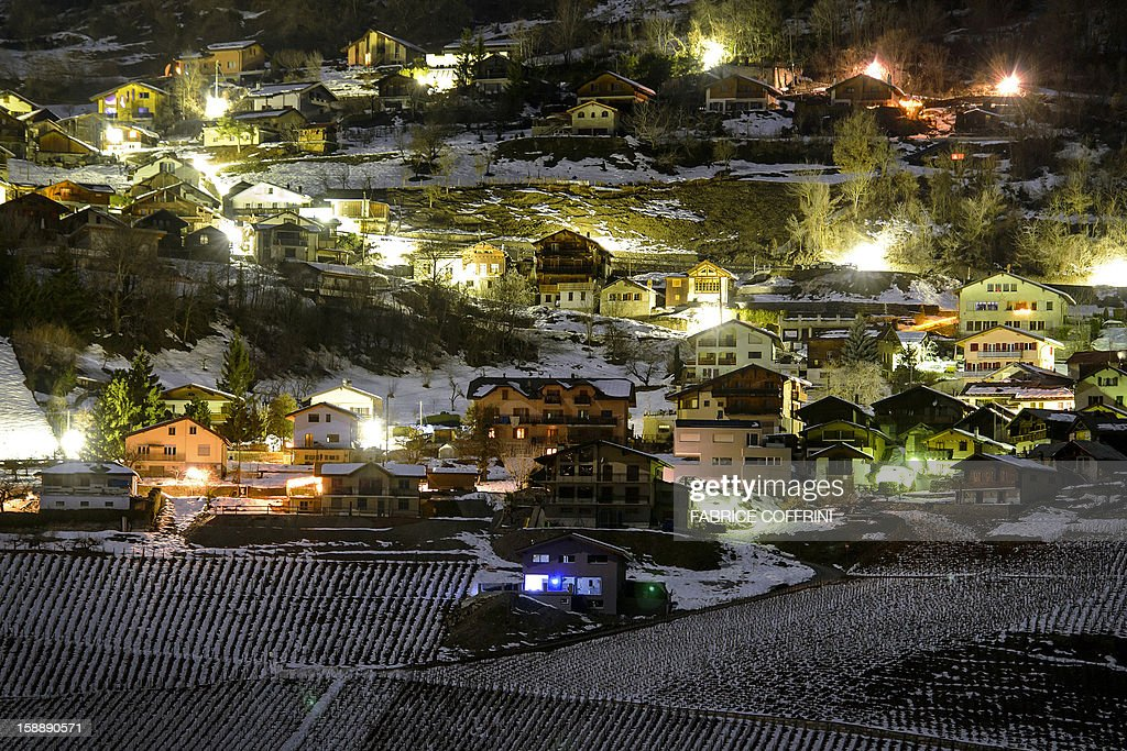 A long exposure general view shows the village of Daillon early on January 3, 2013 after it was closed to the press following a shooting. A gunman has opened fire in a village in southern Switzerland, killing three people and wounding two others, police said on January 3.