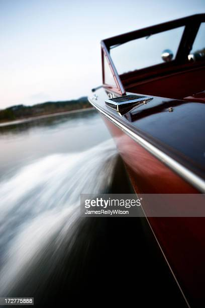 Long exposure of classics wooden boat cruising the lake