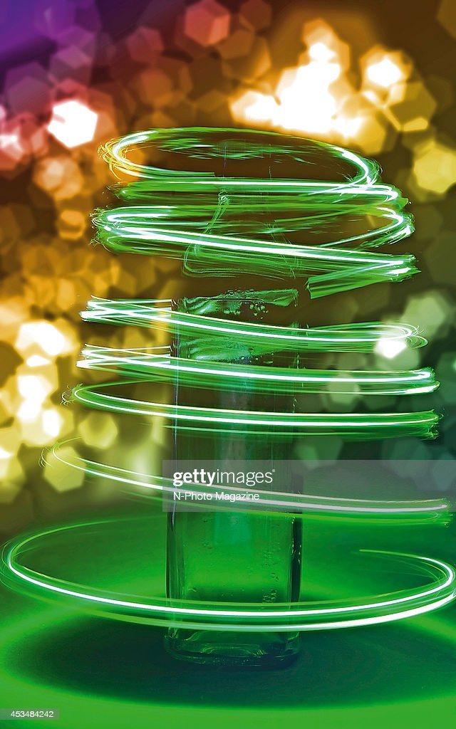 Long exposure of light trails around a vintage olive oil bottle, taken on November 20, 2013.