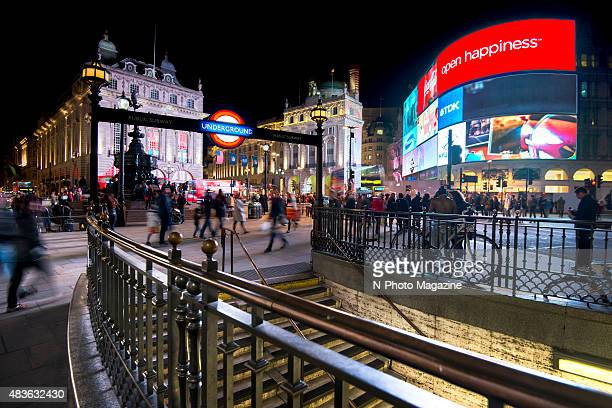 Long exposure of pedestrians and traffic outside Piccadilly Circus tube station in London taken on October 21 2014