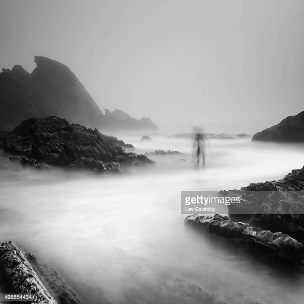 Long exposure photo of a person near cliffs