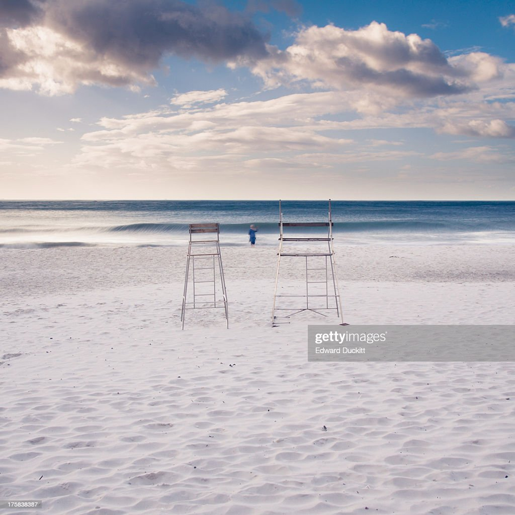 A long exposure photo of two life guard chairs on Clifton 4th beach, Clifton, Western Cape Province, South Africa