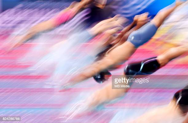 Long exposure picture of swimmers jumping into the pool during the Budapest 2017 FINA World Championships on July 28 2017 in Budapest Hungary