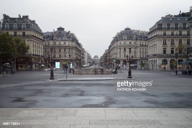 A long exposure picture taken on September 13 2015 in Paris shows the Place de l'Opera without road traffic ahead a carfree day throughout the city...