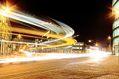 Long exposure, a bus sweeps round the corner of Station Road and Hills Road in Cambridge UK.