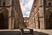 Long exposure view of ancient S Galgano Abbey (Tuscany, Italy), with the open rooftop showing moving clouds