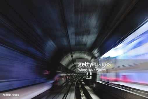 Long Exposure View Of Speeding Train Passing Subway Station