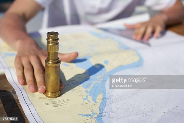 Long glass on a sea chart