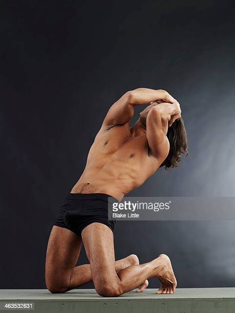 Long haired man on knees  in anguish