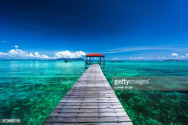 Long jetty with blue sky and turquoise water