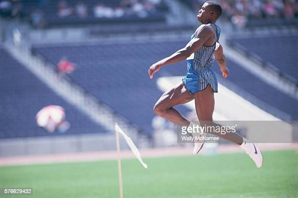 Long jumper Carl Lewis flies through the air on a long jump while competing in the 1996 Olympic Trials Lewis qualified for the Olympic team and went...