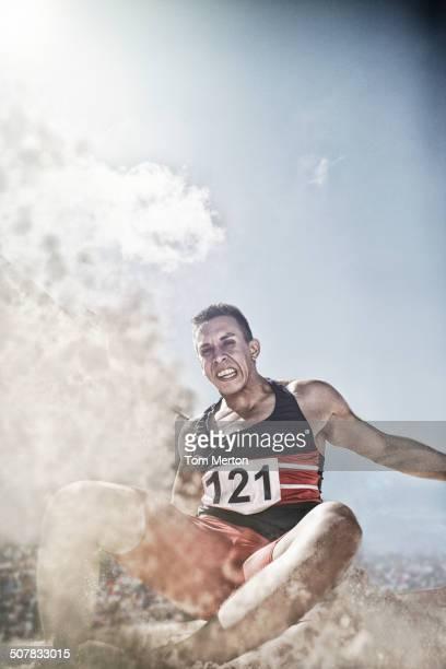 Long jumper landing in sand