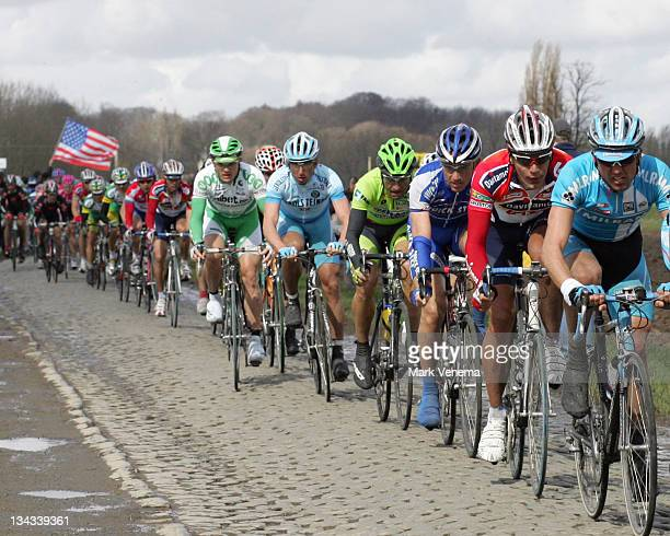 A long line of cyclists riding the famous cobblestones at the 90th edition of the Tour of Flanders in Belgium April 2 2006