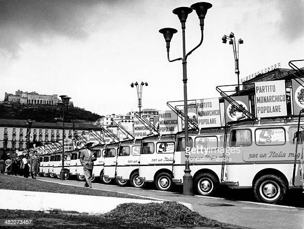 A long line of minivans with speakers standing on the roadside The minivans are used for Italian politician and founder of the People's Monarchist...