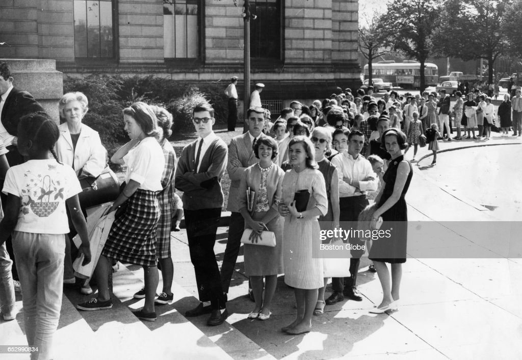 A long line of people wait to see the traveling exhibit of John F. Kennedy's papers and personal possessions at the Museum of Fine Arts in Boston on Aug. 17, 1964, the day the exhibit opened.