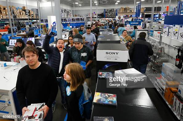A long line of shoppers wait to check out at a Best Buy store with 'Black Friday' deals on November 24 2016 in Orem Utah Retailers kicked off the...