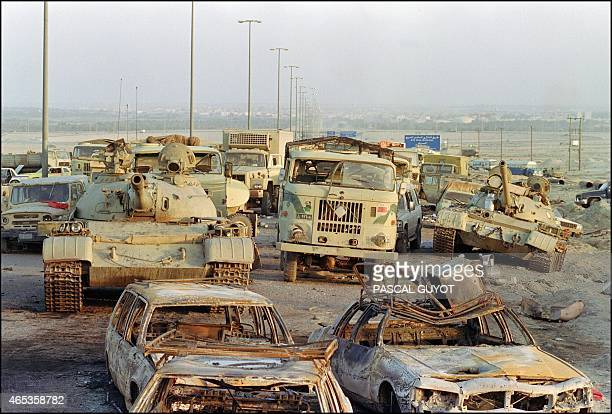 A long line of vehicles including destroyed Iraqi Army Russianmade T62 tanks and trucks stand abandoned by fleeing Iraqi troops on the outskirts of...