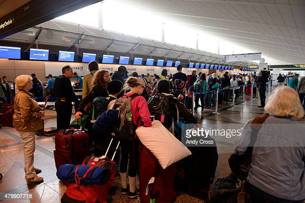 Long lines at the United Airlines ticket counter at Denver International Airport July 08 2015 United experienced a computer network problem Wednesday...