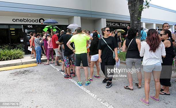 Long lines of people wait at the OneBlood Donation Center to donate blood for the injured victims of the Pulse nightclub shooting on June 12 2016 in...