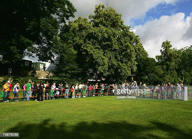 Long lines of spectators queue up prior to day one of the Wimbledon Lawn Tennis Championships at the All England Lawn Tennis and Croquet Club on June...
