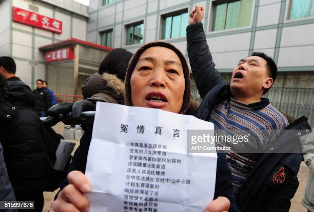 'Long live democracy long live Liu Xiaobo' shouts Beijing resident Song Zaimin as supporters of the leading Chinese and petitioners with their own...