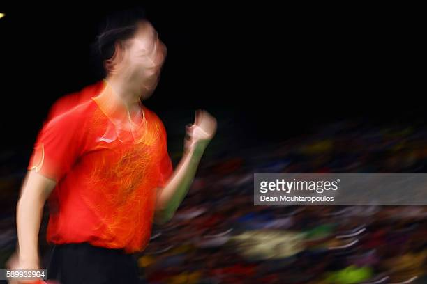 Long Ma of China celebrates a point against Saehyuk Joo of South Korea during the Table Tennis Men's Team Round Semi Final between China and South...