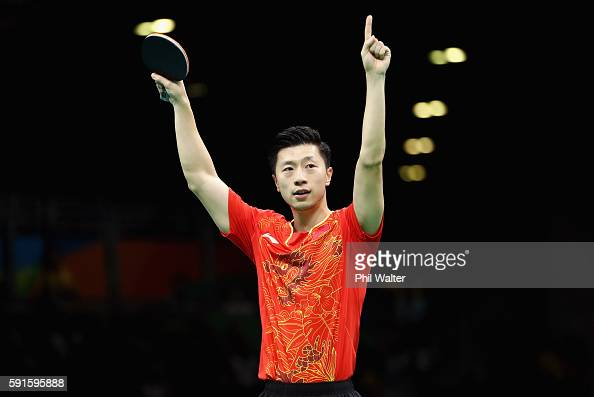 Long Ma of China celebrates during the Men's Table Tennis gold medal match against Koki Niwa of Japan at Riocentro Pavilion 3 on Day 12 of the Rio...