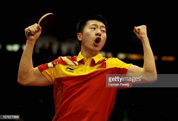 Long Ma of China celebrates his win against Saehyuk Joo of South Korea in the Table Tennis Men's Singles Semifinals at Guangzhou Gymnasium during day...