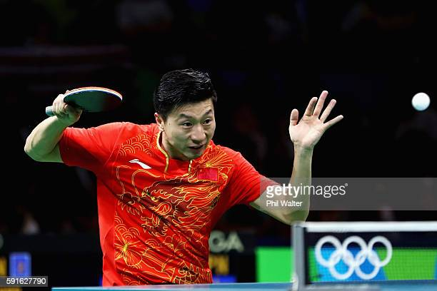 Long Ma of China competes during the Men's Table Tennis gold medal match against Maharu Yoshimura of Japan at Riocentro Pavilion 3 on Day 12 of the...