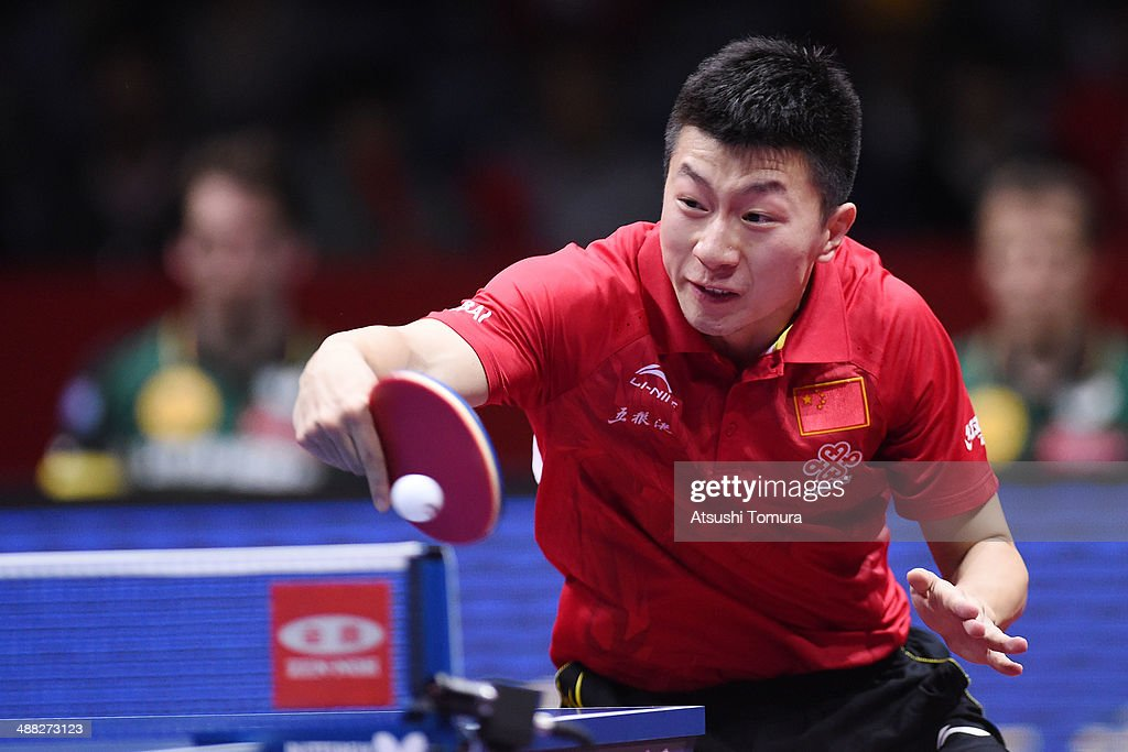Long Ma of China plays a backhand against Timo Boll of Germany during day eight of the 2014 World Team Table Tennis Championships at Yoyogi National Gymnasium on May 5, 2014 in Tokyo, Japan.