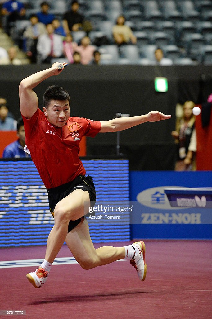 Long Ma of China plays a forehand against Daniel Habesohn of Austria during day five of the 2014 World Team Table Tennis Championships at Yoyogi National Gymnasium on May 2, 2014 in Tokyo, Japan.