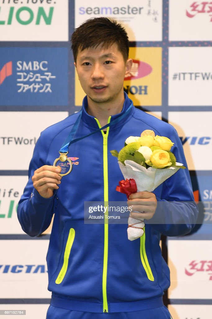 Long Ma of China poses with the gold medal after winning the men's singles on the day 5 of the 2017 ITTF World Tour Platinum LION Japan Open at Tokyo Metropolitan Gymnasium on June 18, 2017 in Tokyo, Japan.