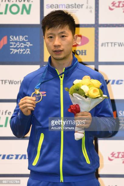 Long Ma of China poses with the gold medal after winning the men's singles on the day 5 of the 2017 ITTF World Tour Platinum LION Japan Open at Tokyo...