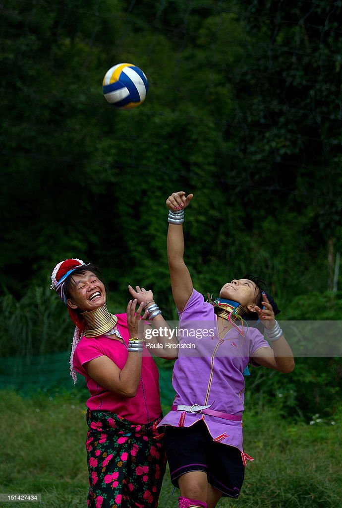 Long Neck Karen women play volleyball after the tourists are gone at the Baan Tong Luang hill tribe village on September 6, 2012 in Maerim, Thailand. Baan Tong Luang is a fabricated village containing 6 separate Thai Hill Tribes where visitors are expected to pay $16 or 500 Thai bhat for the entrance fee. The ethnic tribes include the Lahu, Hmong, White Karen, Long necked Karen, Yao, Akha. The village opened since 2005 attempts to preserve the old traditions of the ethnic Hill Tribe, also providing an income for them. Life for many of Thailand's Hill Tribe population can be difficult since it can be hard for them to make a living. Their language, costume and culture are different along with the frequent legal problems over Thai citizenship. Hill tribe is a term used in Thailand for all of the various tribal peoples who migrated from Tibet, or elsewhere in China over the past few centuries.