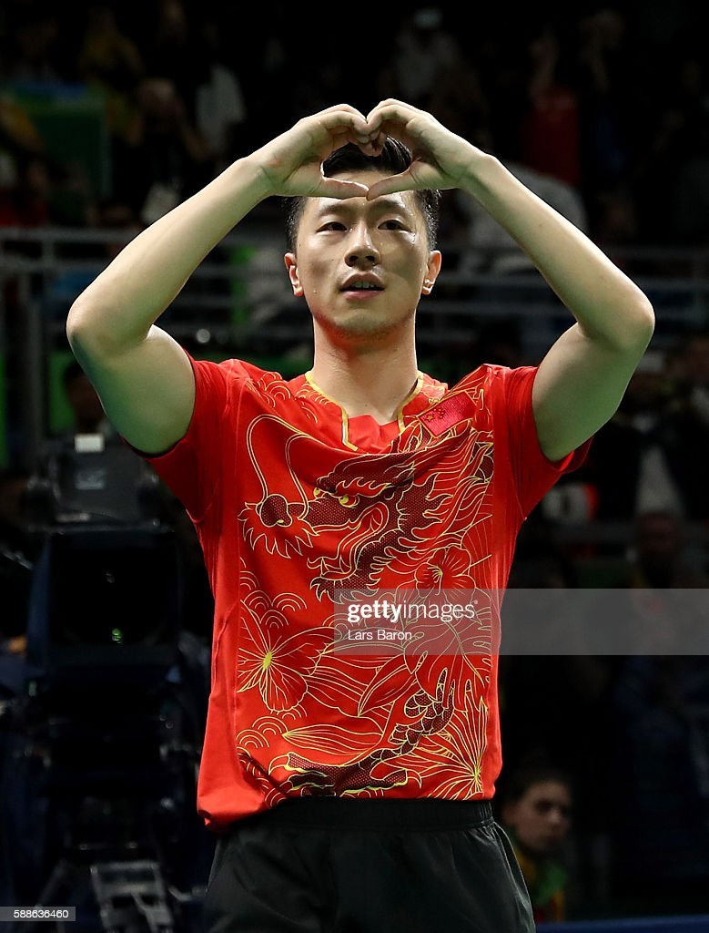 MA Long of China celebrates after winning the Mens Table Tennis Gold Medal match between Ma Long of China and Zhang Jike of China at Rio Centro on August 11, 2016 in Rio de Janeiro, Brazil.