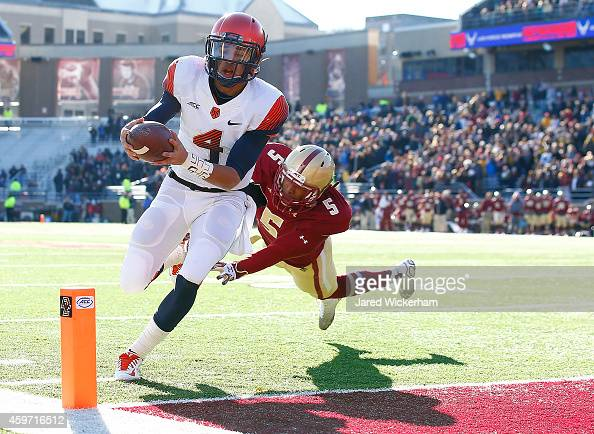 Long of the Syracuse Orangemen runs in for a touchdown past TyMeer Brown of the Boston College Eagles in the first half during the game at Alumni...
