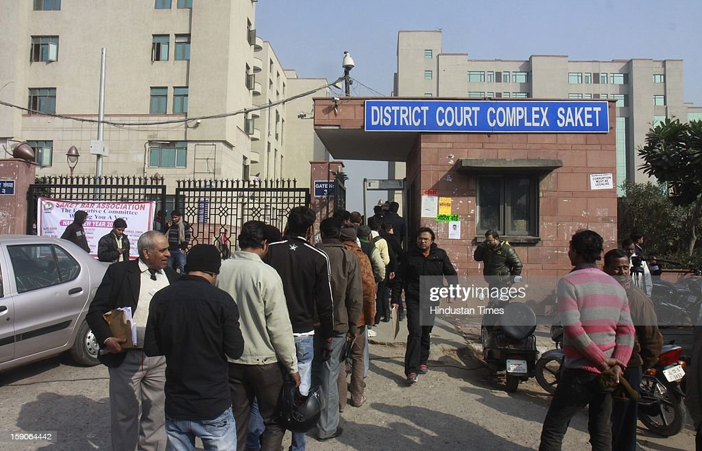 Long Queue of people seen at the gate of Saket court due to heavy security deployed for the accused of gang rape hearing at the Saket district court on January 7, 2013 in New Delhi, India. The men are accused of a gang rape of a 23 year old girl who later died due to injuries. The incident has caused outrage across India, sparking protests and demands for tough new rape laws and led to setting of special fast track courts exclusively for offences against women.
