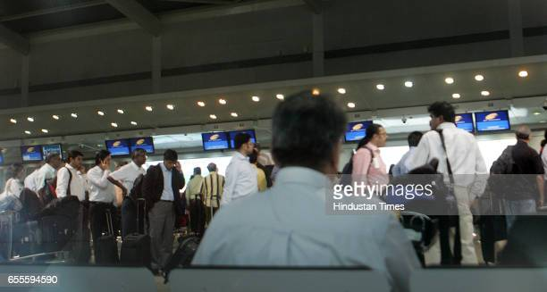 Long queues at Mumbai airport becuase aiirlines were forced to issue baording passes manually after runway repair workers were dug into a data cable...