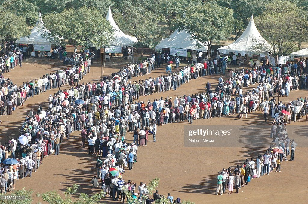 Long queues form as voters wait to cast their votes on March 4, 2013 at Jomo Kenyatta sports ground polling station in Kisumu County, Kenya. Kenya's last General elections resulted in mass violence across the country. Violence has been reported in 2013 elections in Mombasa with four policeman killed. This is the first General Election under the new constitution enacted in 2010.