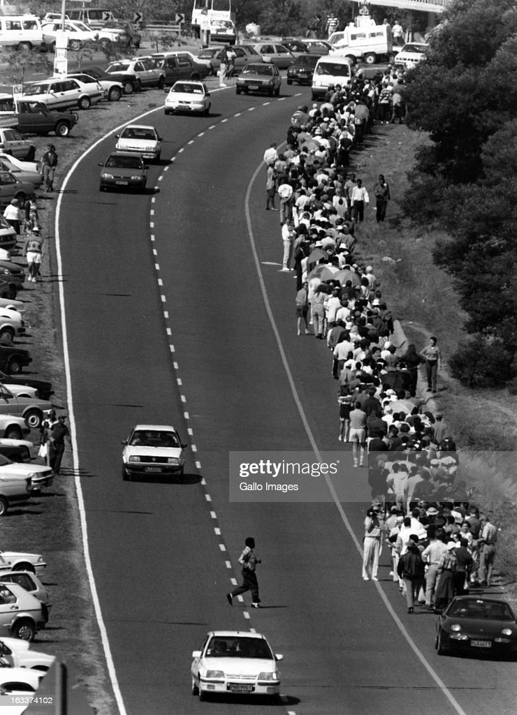 Long queues of voters line the William Nicol highway waiting to vote during the 1994 general elections on April 27, 1994 Johannesburg, in South Africa.