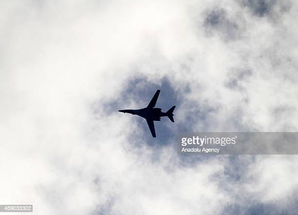 B1B long range bomber aircraft of USled coalition flying over the Kobani city during the clashes between Islamic State of Iraq and Levant members and...