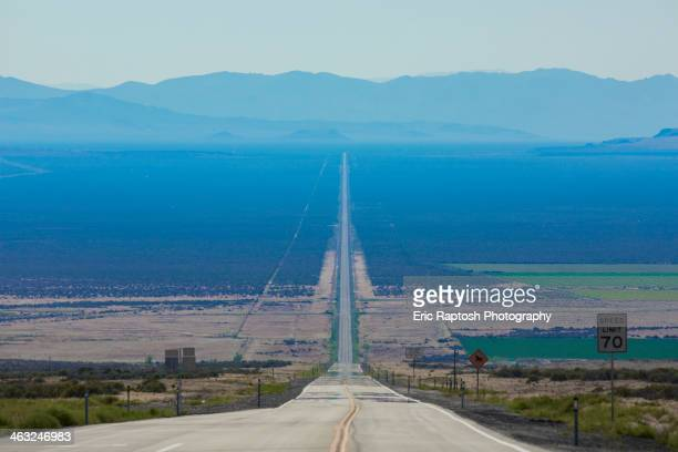 Long road through rural landscape, Orovada, Nevada, United States,