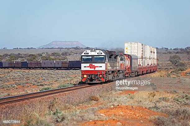 Long SCT freight train passing through outback country
