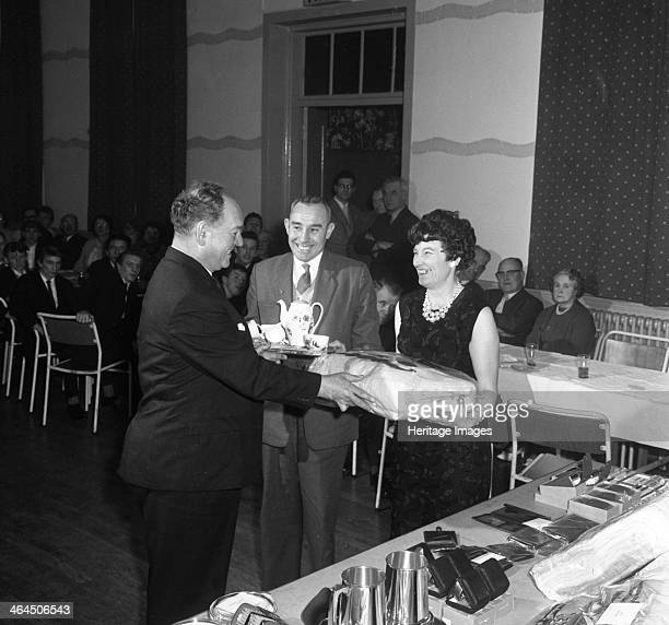 Long service presentation Horden County Durham 1963 In the time honoured tradition a couple receive a tea service and gifts for long service to the...