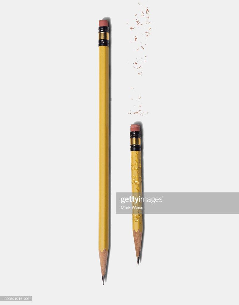 Long sharp pencil and short chewed pencil : Stock Photo