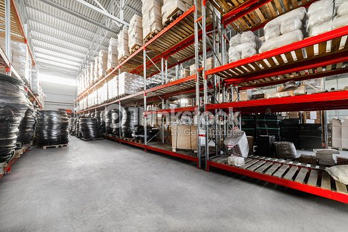 Long shelves with a variety of boxes and container : Stock Photo