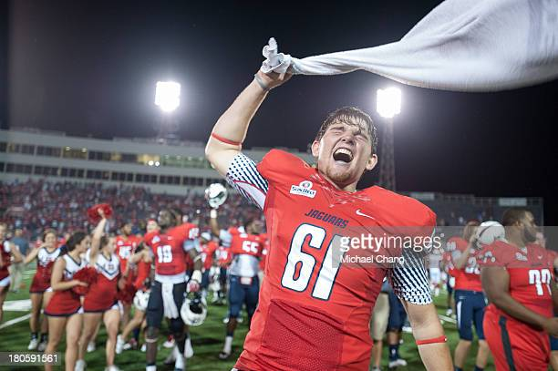 Long snapper Austin Cole of the South Alabama Jaguars celebrates after defeating the Western Kentucky Hilltoppers on September 14 2013 at LaddPeebles...